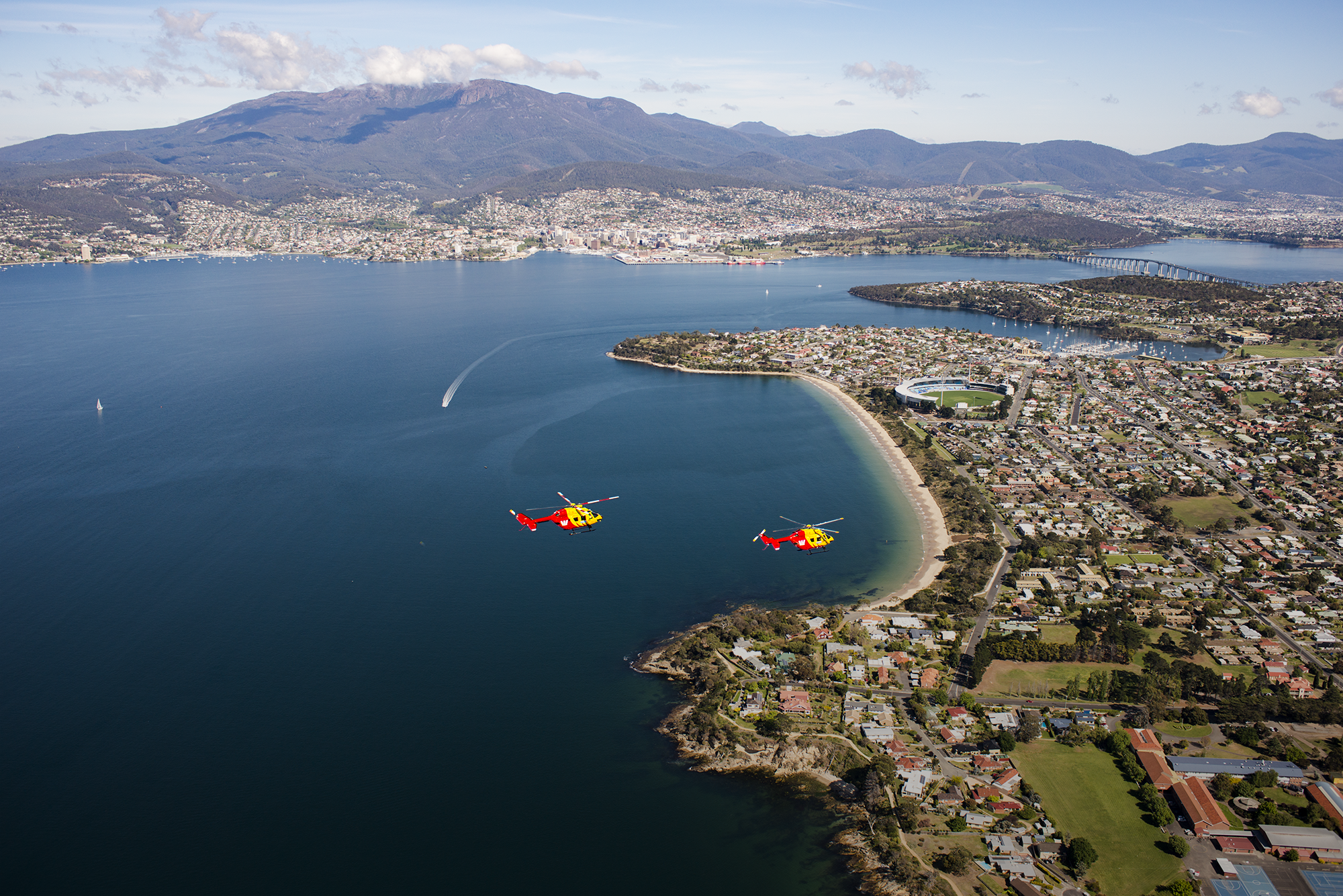 Westpac Rescue Helicopters flying over Bellerive