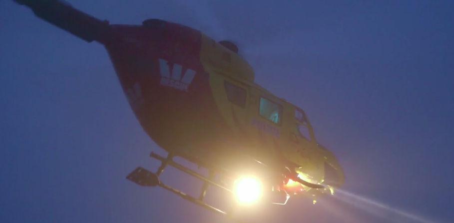 Helicopter at night with search lights on