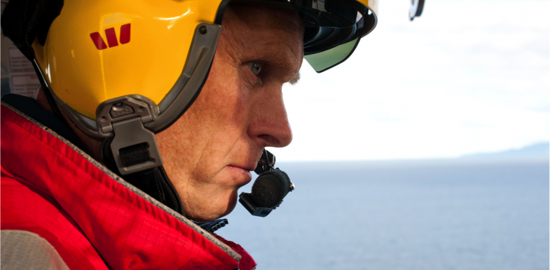Westpac Rescue Helicopter crew member looking out over the sea