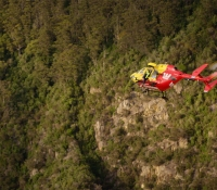 Westpac Rescue Tasmania Helicopter over Bush
