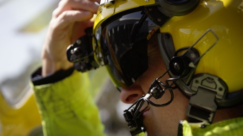 Pilot adjusting his helmet visor
