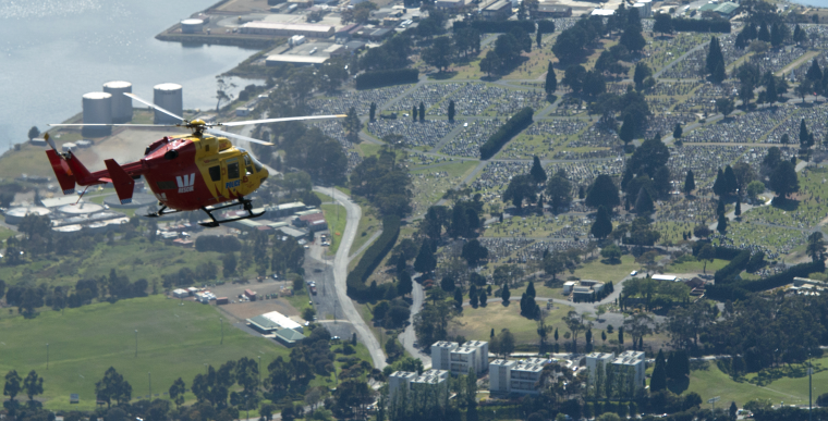 Westpac Rescue Helicopter flying over Cornelian Bay Cemetery